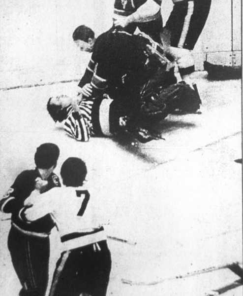 New Haven Blades goalie Jim Armstrong takes down linesman Gordie Heagle during a brawl in Game 7 of a playoff series in Syracuse against the Blazers after Heagle punched Blades defenseman Blaine Rydman. It would by the final game in New Haven Blades history. (Photos by Kirby Kennedy/Register file photos)